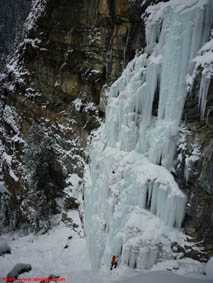 ice climber below The Pillars near Field, BC