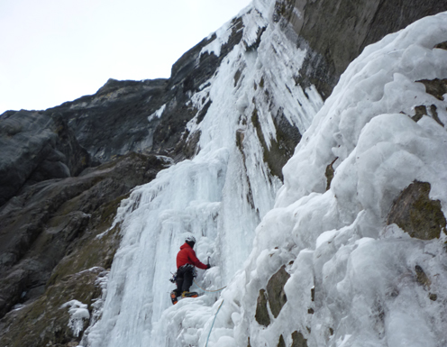 ice climber in Nemesis, a classic ice route in the Canadian Rockies