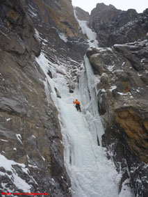 Climbing up one of the WI3 ice pitches on Facile Monster.